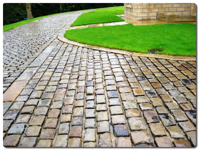 Driveway Using Gritstone Cobbles And Kerbs on Concrete Form Construction