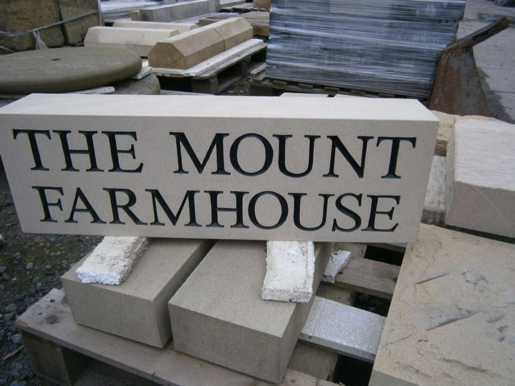 hand carved stone sign